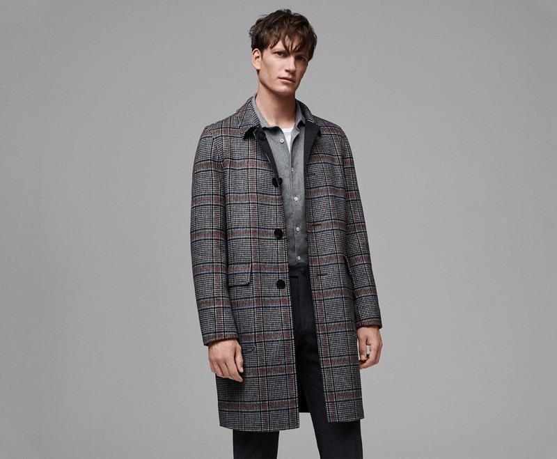 Belgian model Florian Van Bael sports a sleek look from Jigsaw's fall-winter 2019 men's collection.