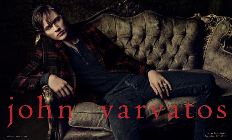 Lucky Blue Smith dons a tartan blazer with a henley and skinny jeans for John Varvatos' fall-winter 2019 campaign.