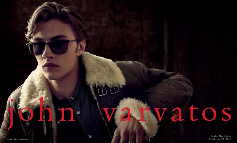 Rocking sunglasses and a brown shearling jacket, Lucky Blue Smith stars in John Varvatos' fall-winter 2019 campaign.