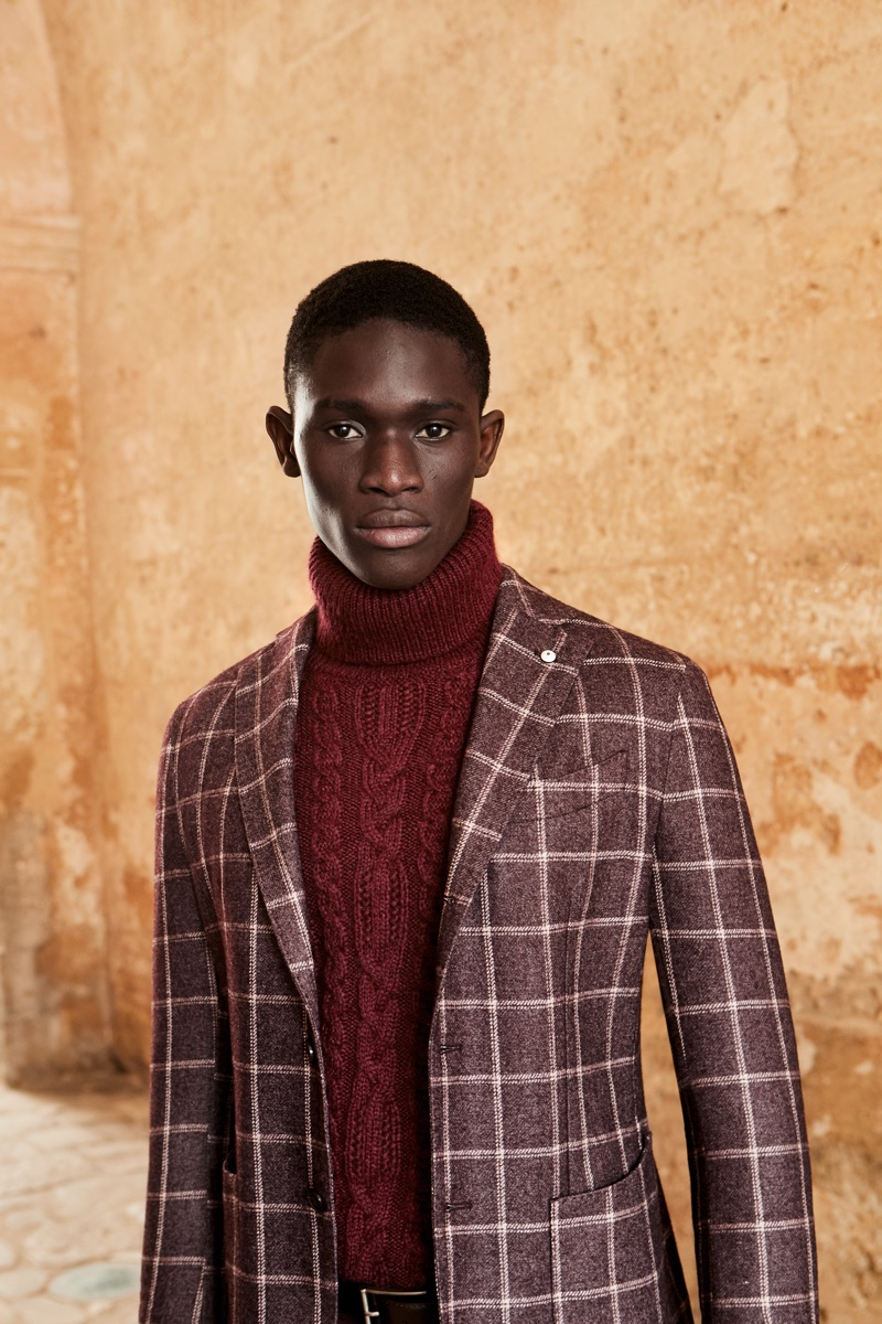 A chic vision, Paco Diouf dons an ensemble in wine-colored hues from L.B.M. 1911's fall-winter 2019 collection.