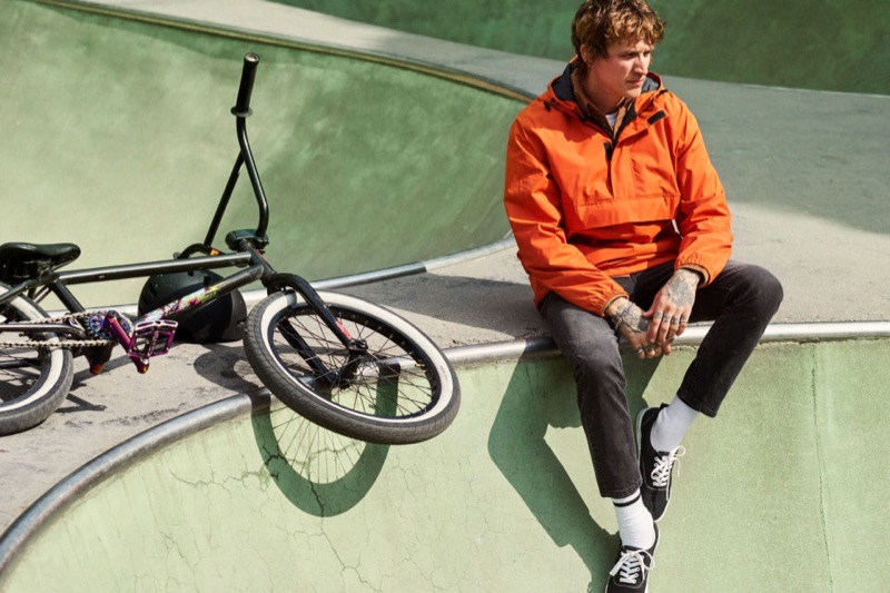 Leebo Freeman sports an orange anorak with black skinny jeans from H&M.