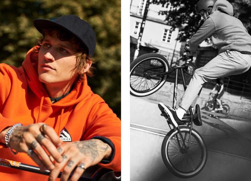 Riding his bike, Leebo Freeman rocks an orange hoodie from H&M.