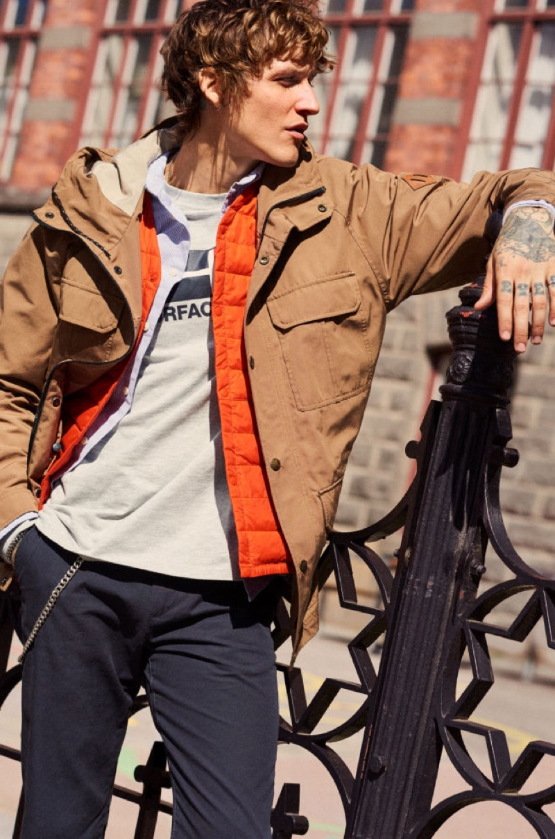 Layering for fall, Leebo Freeman wears a hooded jacket and more by H&M.