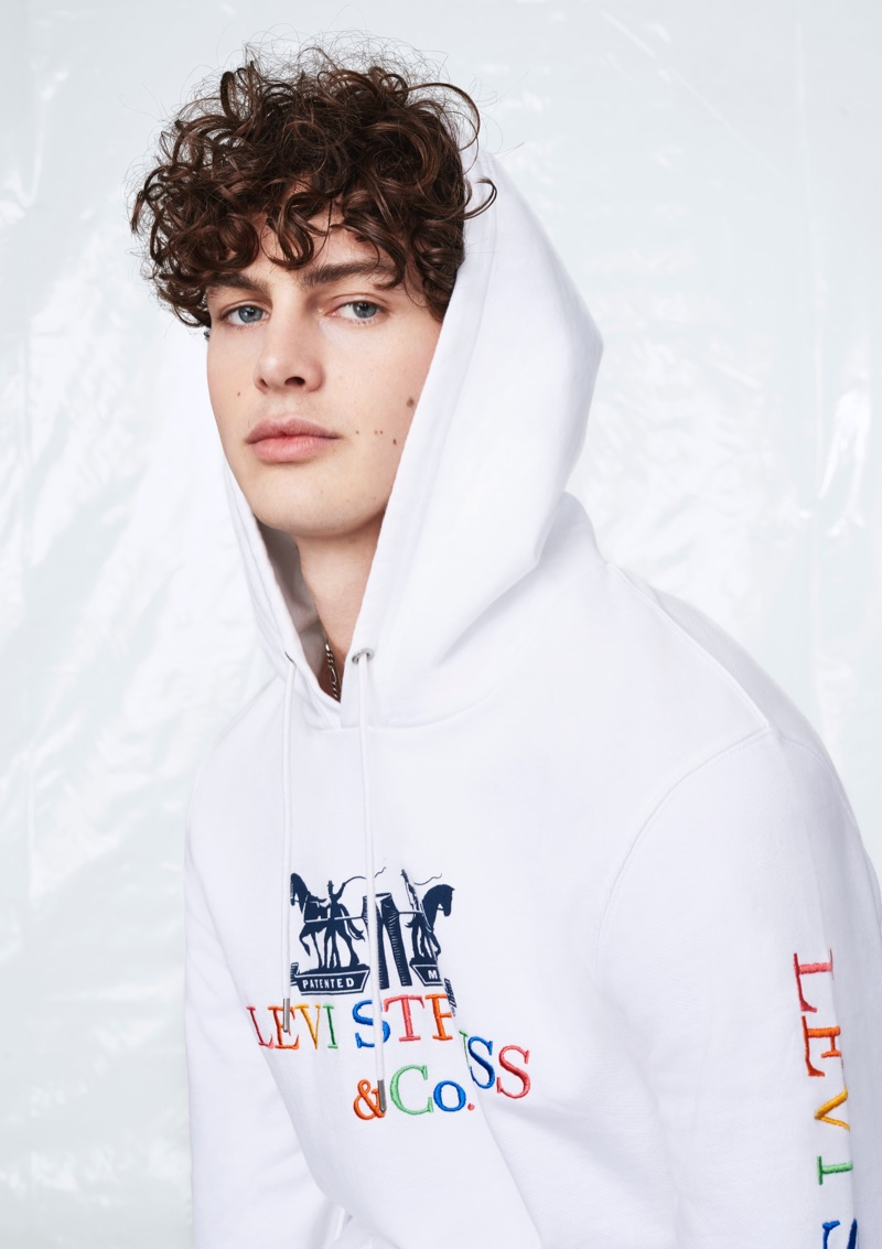Darwin Gray sports a 90s logo hoodie from Levi's.