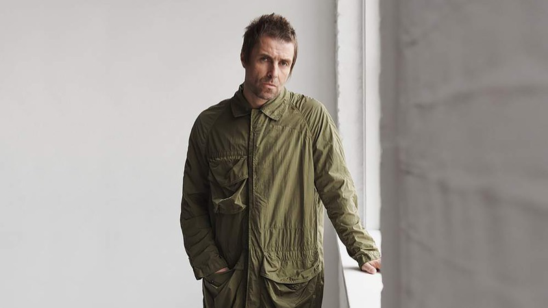 Front and center, Liam Gallagher wears a Burberry nylon coat.