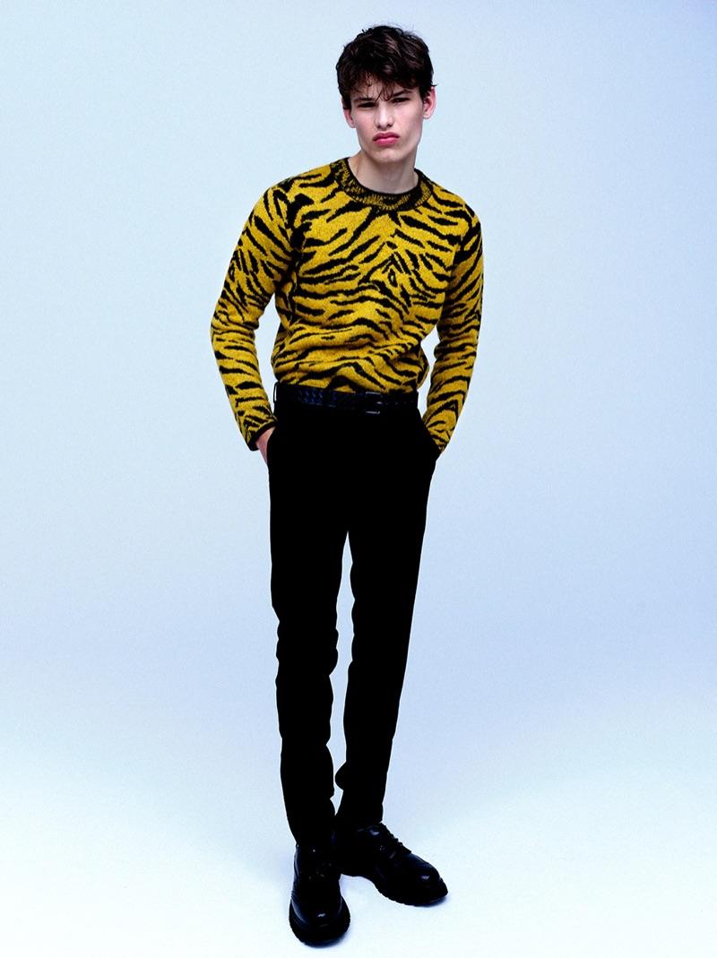 Making a bold statement, Louis Gockenjan rocks a zebra print Saint Laurent sweater $990.