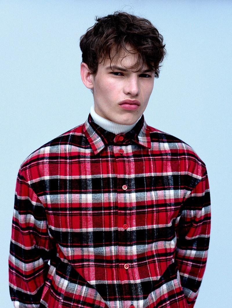 Front and center, Louis Gockenjan wears a Balenciaga checked flannel shirt $1,450 and Bottega Veneta turtleneck sweater $980.