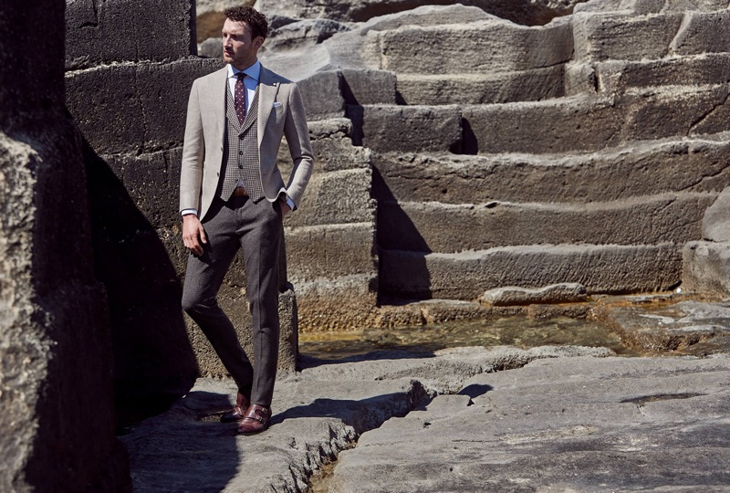 Wearing pleated trousers with a waistcoat and suit jacket, Jacob Coupe appears in Luigi Bianchi Mantova's fall-winter 2019 campaign.