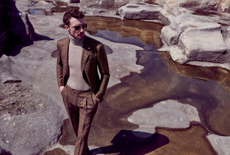 Jacob Coupe dons a brown checked suit with a turtleneck sweater for Luigi Bianchi Mantova's fall-winter 2019 campaign.