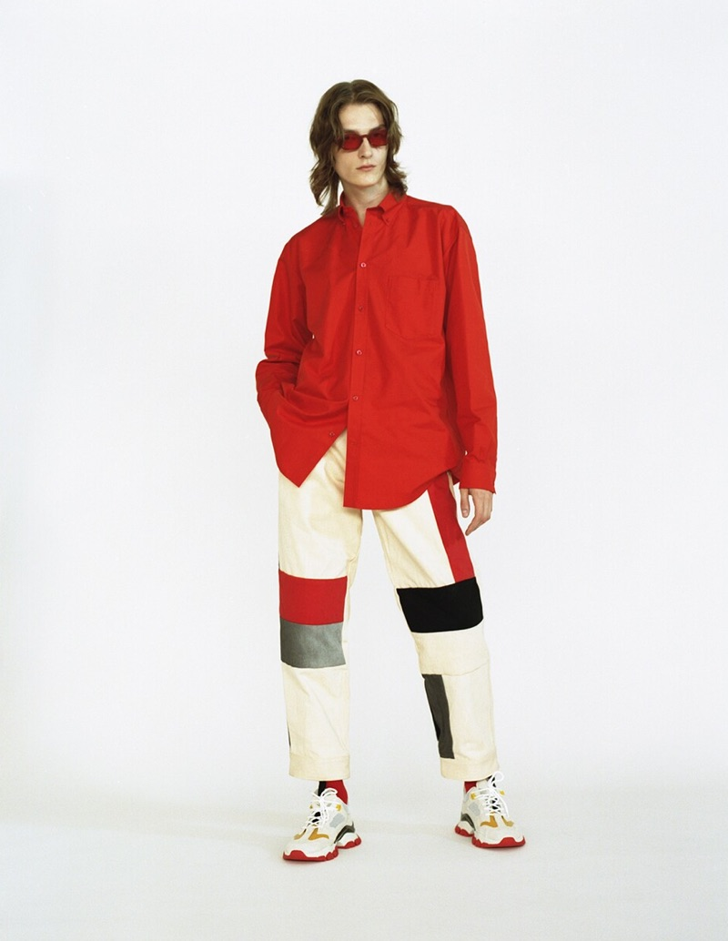 Front and center, Alex Rychkov wears red Chimi sunglasses $149, a Balenciaga shirt $895, GR Uniforma x Diesel Red Tag patchwork pants $625 and Moncler sneakers $665.