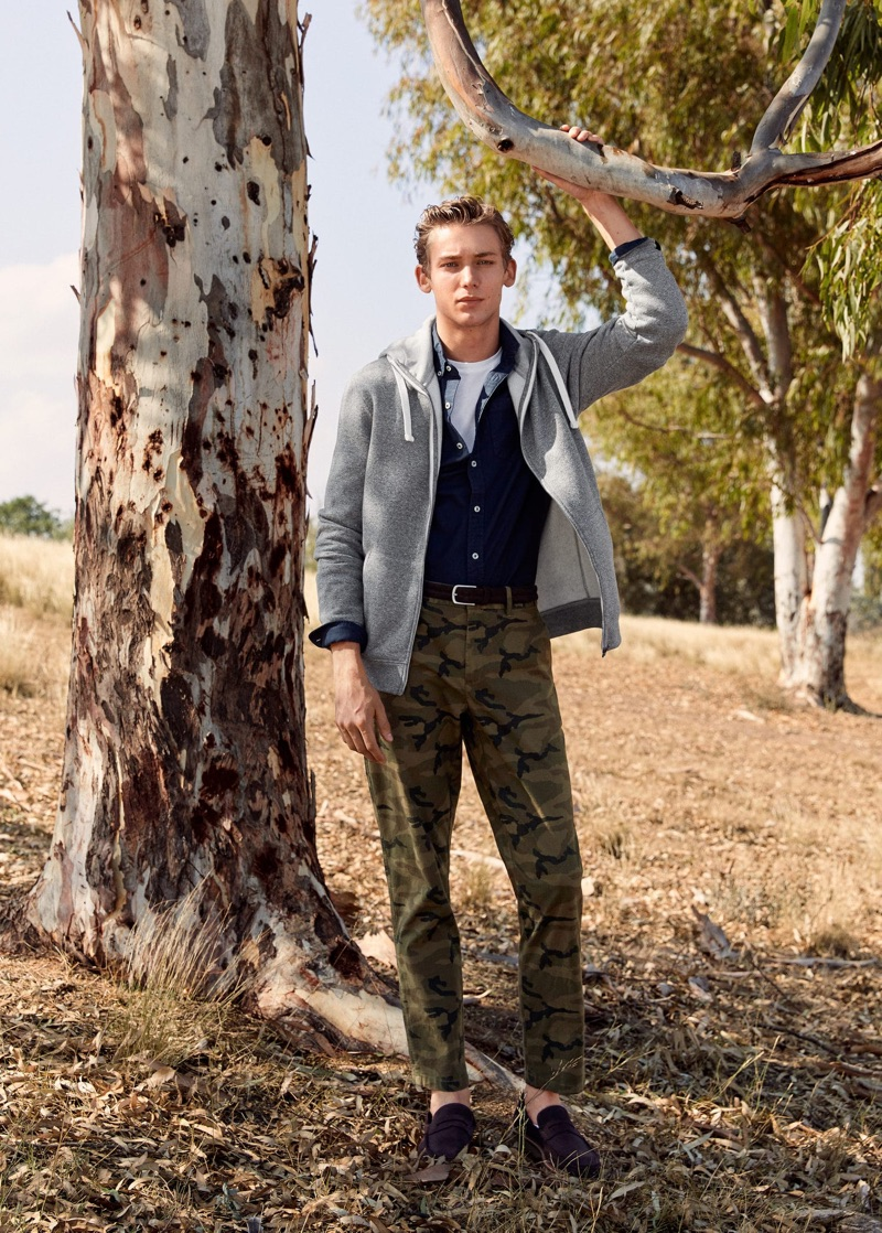 Making a case for camouflage, Christopher Einla wears Mango's statement pants with timeless essentials.