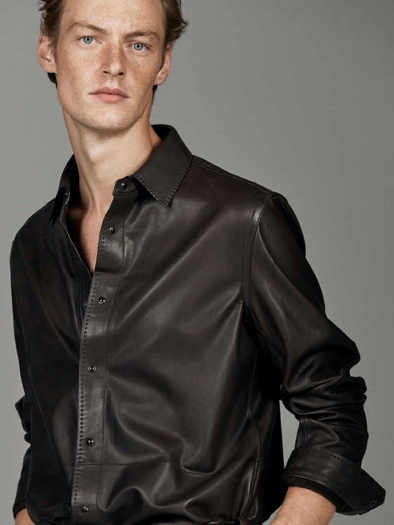 Making a luxurious statement, Roberto Sipos dons a leather shirt from Massimo Dutti's fall-winter 2019 runway collection.
