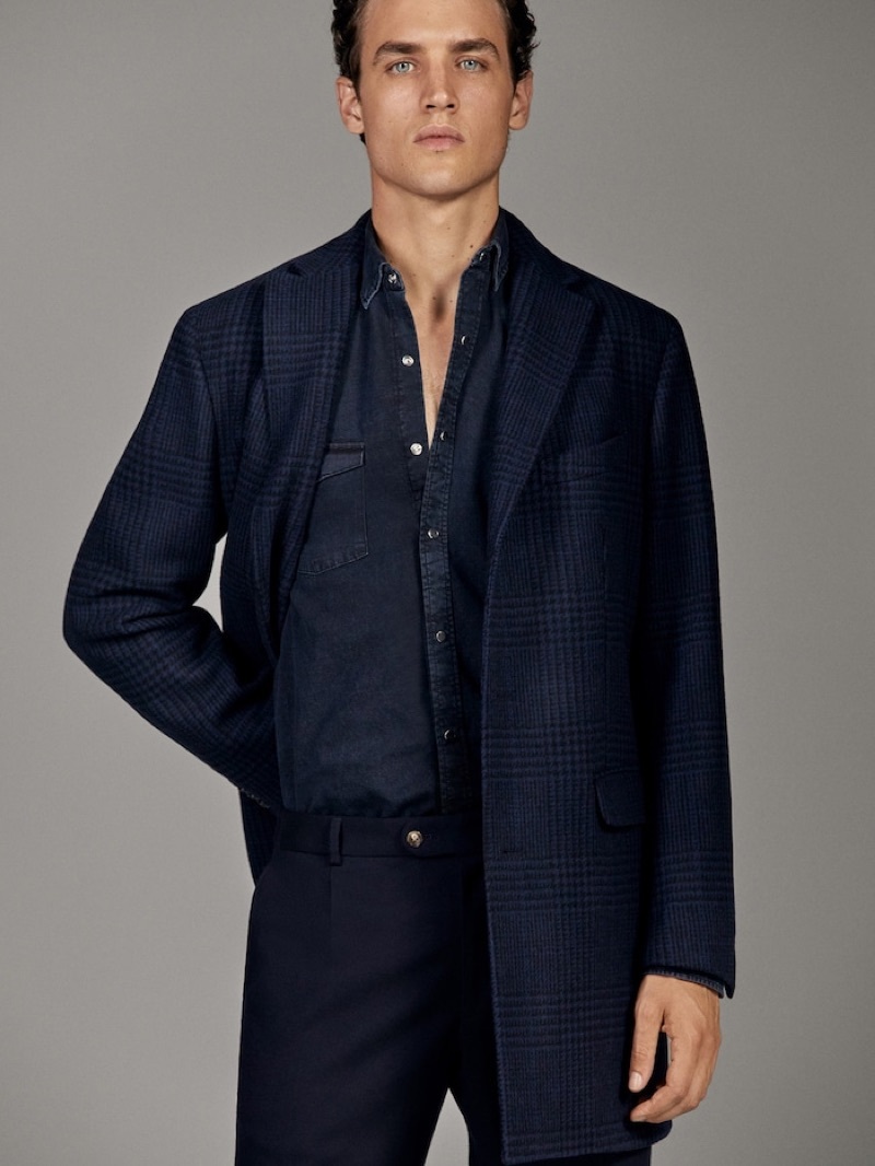 Front and center, Federico Novello dons a navy number from Massimo Dutti's fall-winter 2019 runway collection.