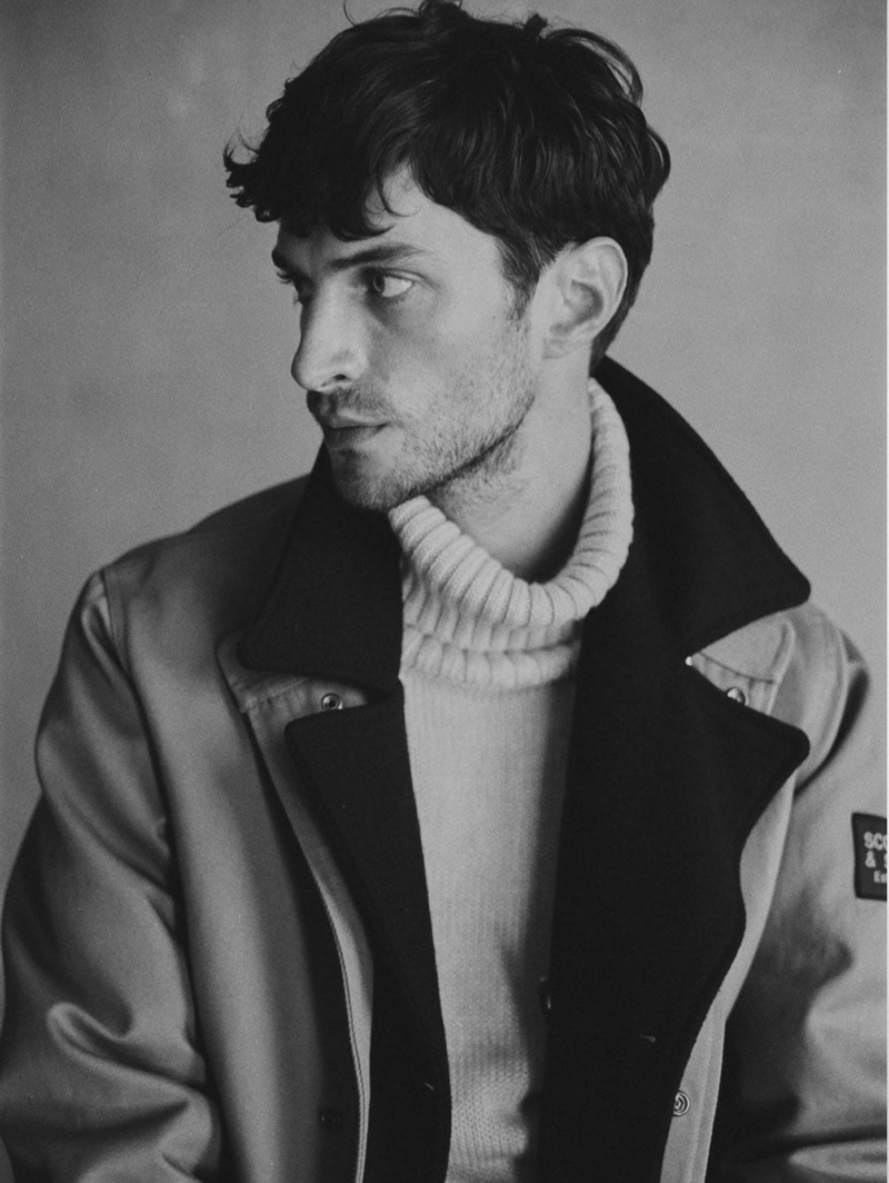 Connecting with Scotch & Soda, Matthew Bell models the brand's twill jacket $385 with a turtleneck sweater.