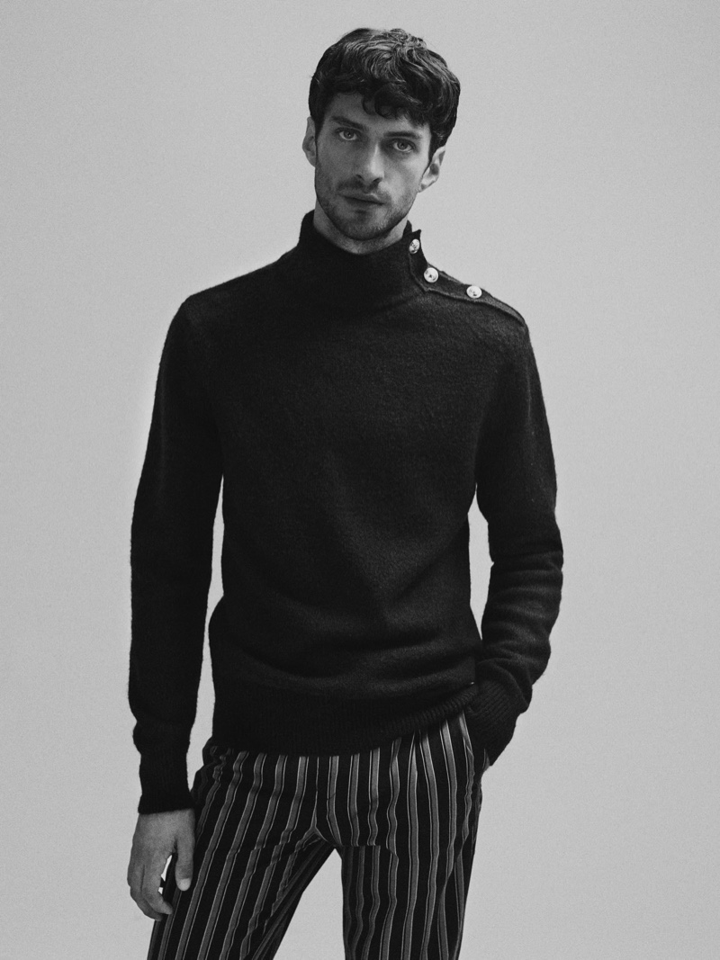 Front and center, Matthew Bell dons a turtleneck sweater with striped chinos $145 from Scotch & Soda.