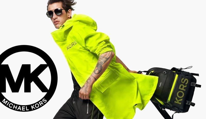 Embracing a bold splash of color, Austin Augie stars in Michael Kors' summer 2019 campaign.