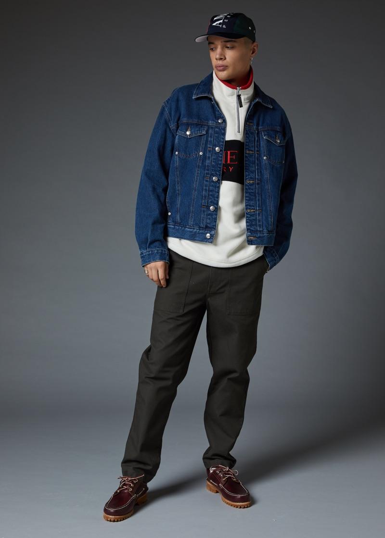 Making a case for sporty style, Lancelot Prat wears a Perry Ellis logo denim jacket and half-zip sweatshirt.
