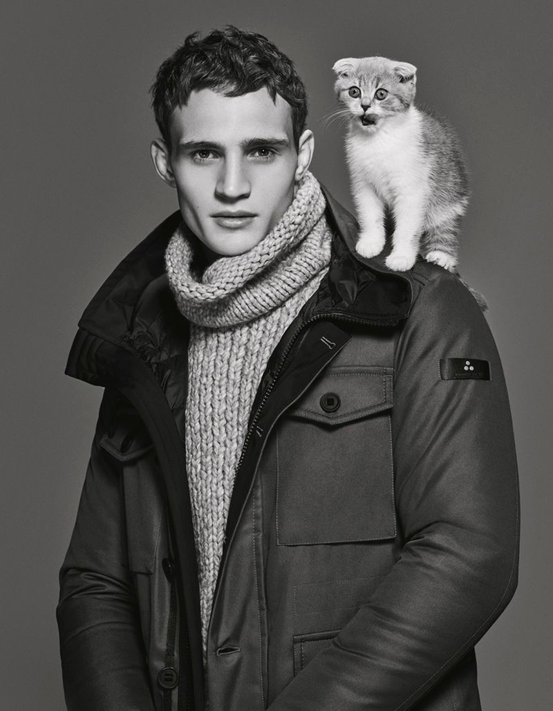 Julian Schneyder poses with a cat for Peuterey's fall-winter 2019 men's campaign.