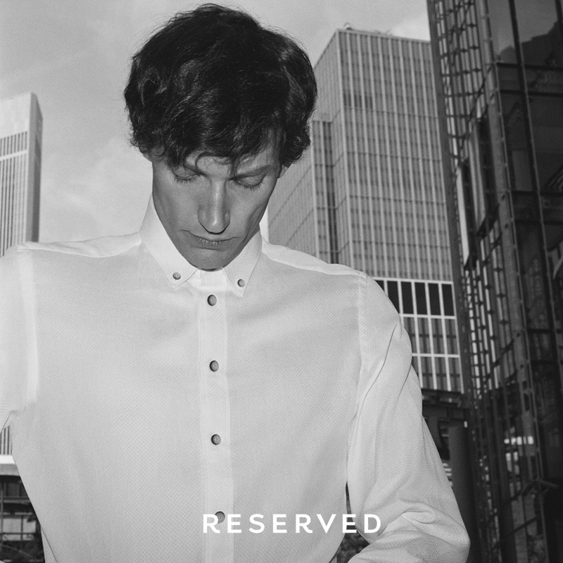 Connecting with Reserved, Thilo Muller dons a classic white shirt.