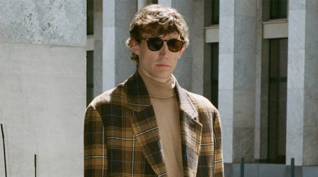 Thilo Muller dons a plaid coat and turtleneck sweater by Reserved.