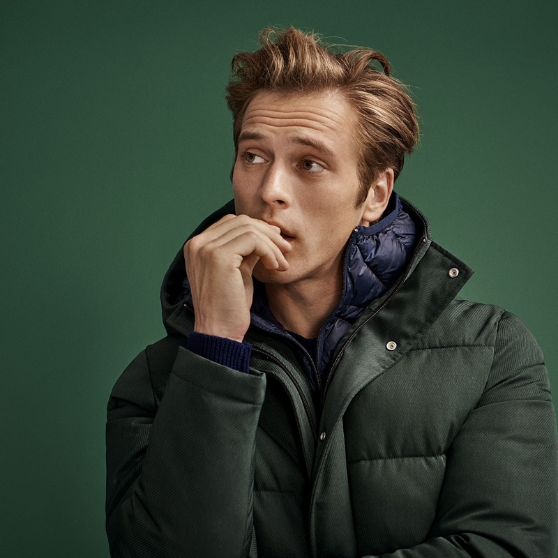 Model Jules Raynal dons a puffer jacket from Selected Homme.