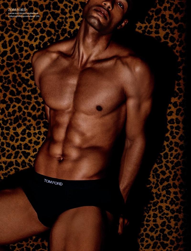 Shirtless Michael Ayeboua models black Tom Ford underwear briefs for Holt Renfrew.