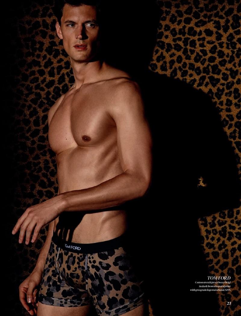 Shirtless Garrett Neff dons animal print underwear from Tom Ford.