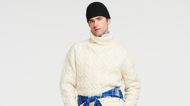 A chic but sporty vision, Sean O'Pry rocks a Tommy Hilfiger cable-knit turtleneck sweater with stretch pants.