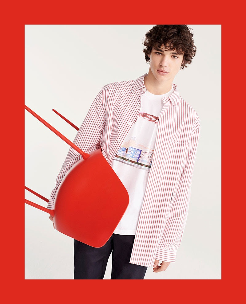 Connecting with YOOX, Fernando Lindez wears a red and white striped shirt with a graphic tee.