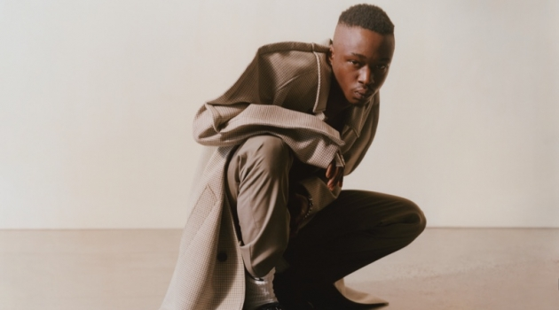Connecting with MatchesFashion, Ashton Sanders rocks a Maison Margiela coat and trousers with Bottega Veneta shoes.