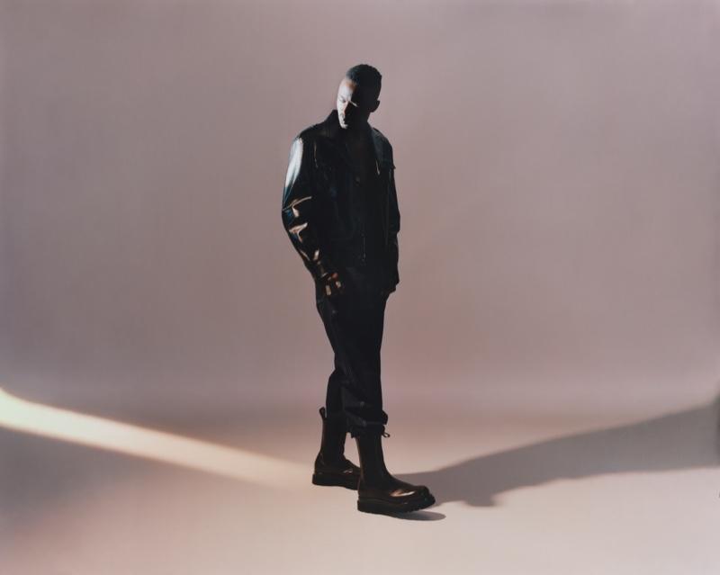 Clad in designer fashions, Ashton Sanders wears a Prada jacket, Marni trousers, and Bottega Veneta boots.