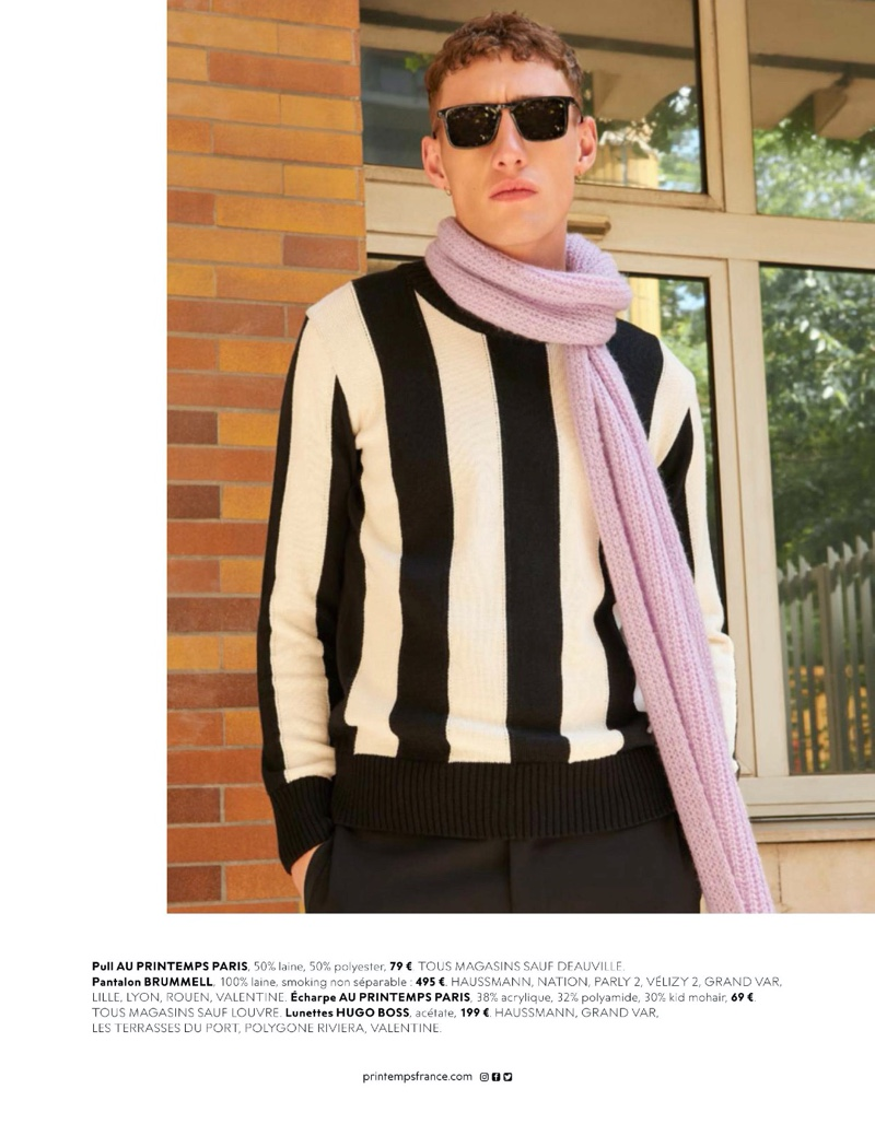 Aubrey O'Mahony wears a Printemps Paris sweater and scarf with Brummell trousers and sunglasses by Hugo Boss.