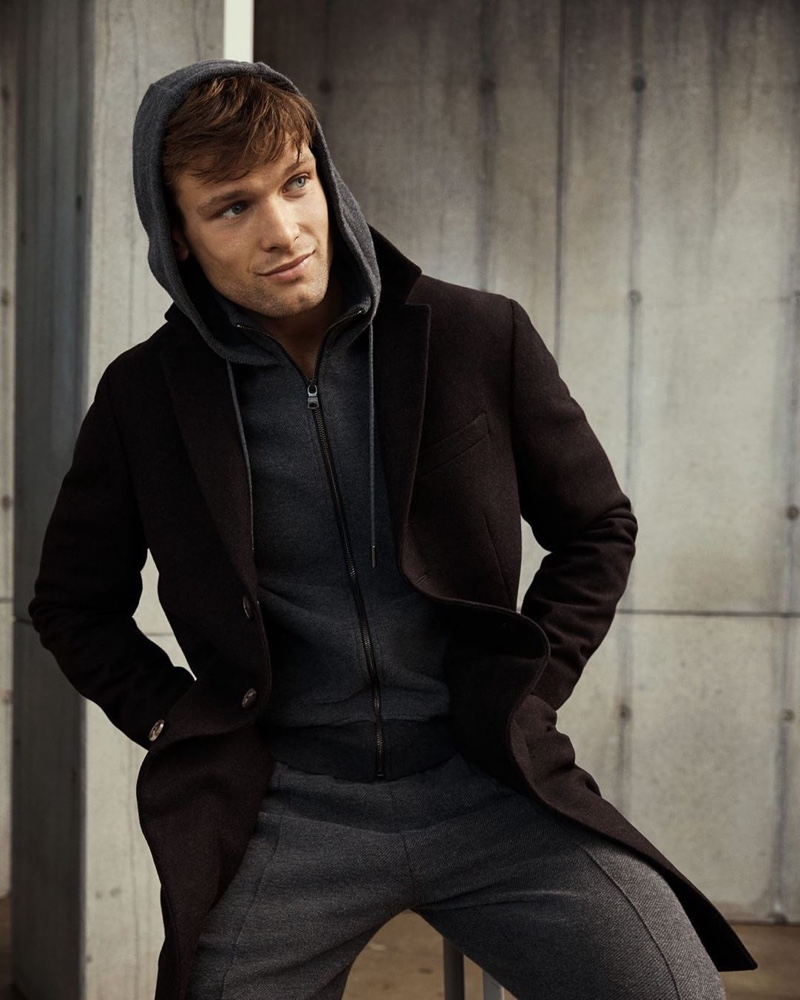 Sporting a full-zip hoodie and matching joggers, Elliott Reeder wears Banana Republic.