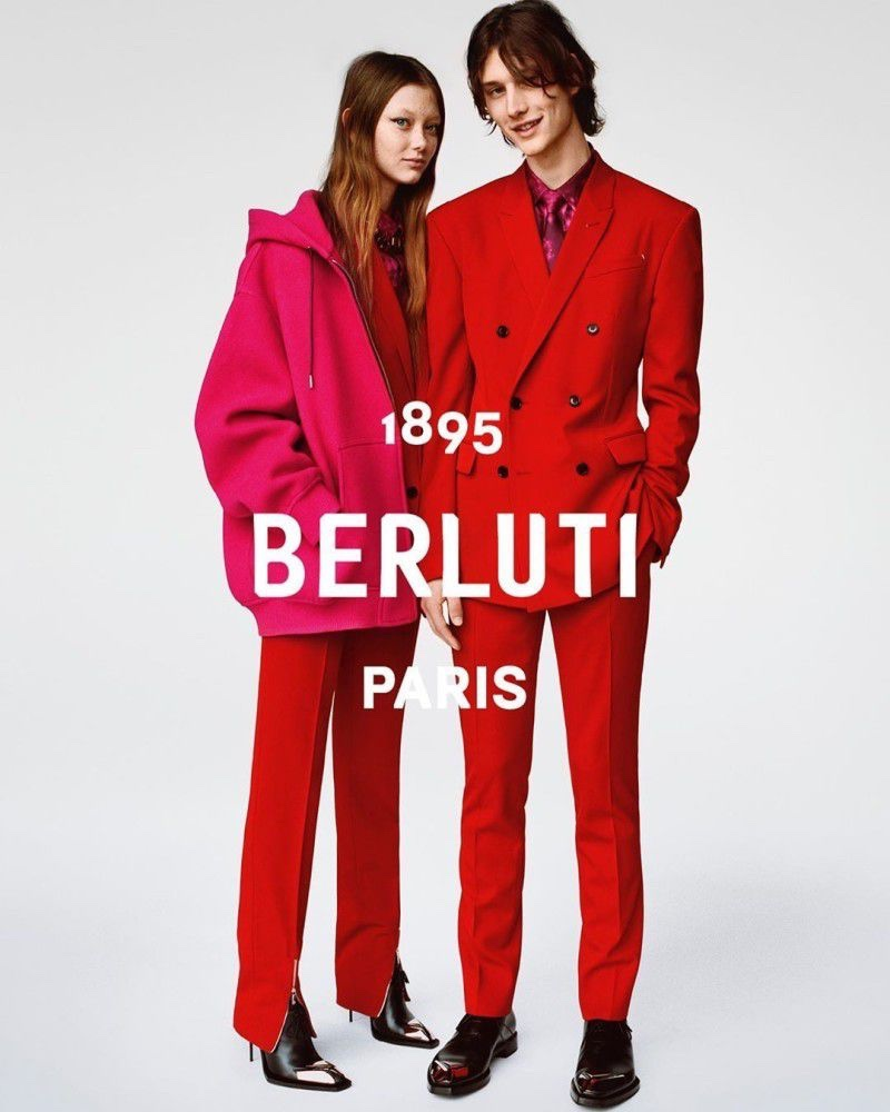 Standing out in red suits, models Sara Grace Wallerstedt and Wellington Grant appear in Berluti's fall-winter 2019 campaign.