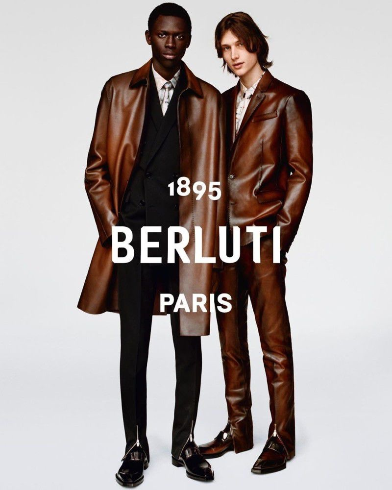 Donning brown leather suiting and outerwear, models Khadim Sock and Wellington Grant front Berluti's fall-winter 2019 campaign.