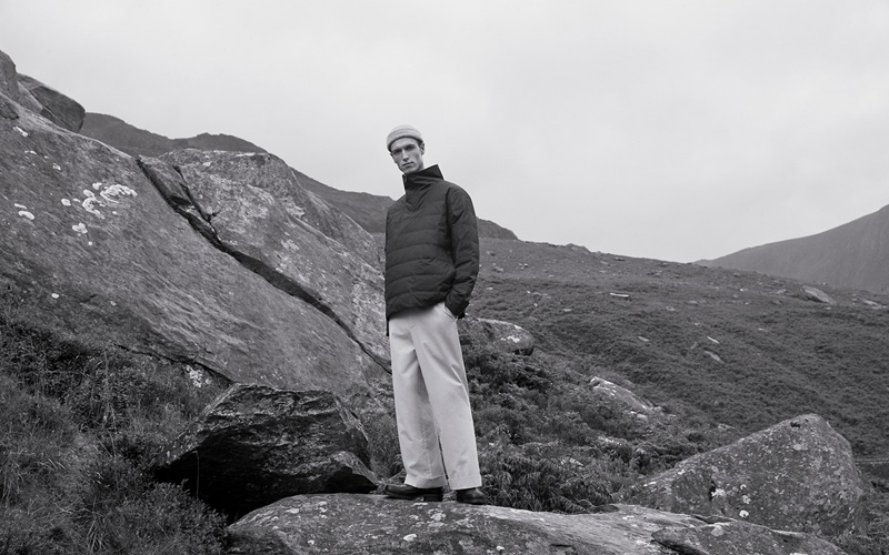 Traveling to the Snowdonia Mountains, Egon Van Praet wears a fall 2019 look from COS.