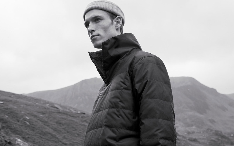 Model Egon Van Praet sports a puffer jacket from COS' fall 2019 men's collection.
