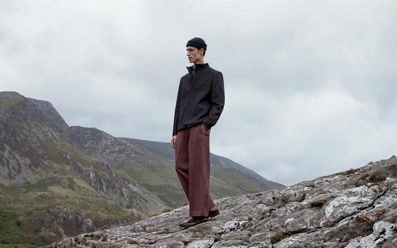 Embracing minimal style, Egon Van Praet wears a fall-winter 2019 look from COS.