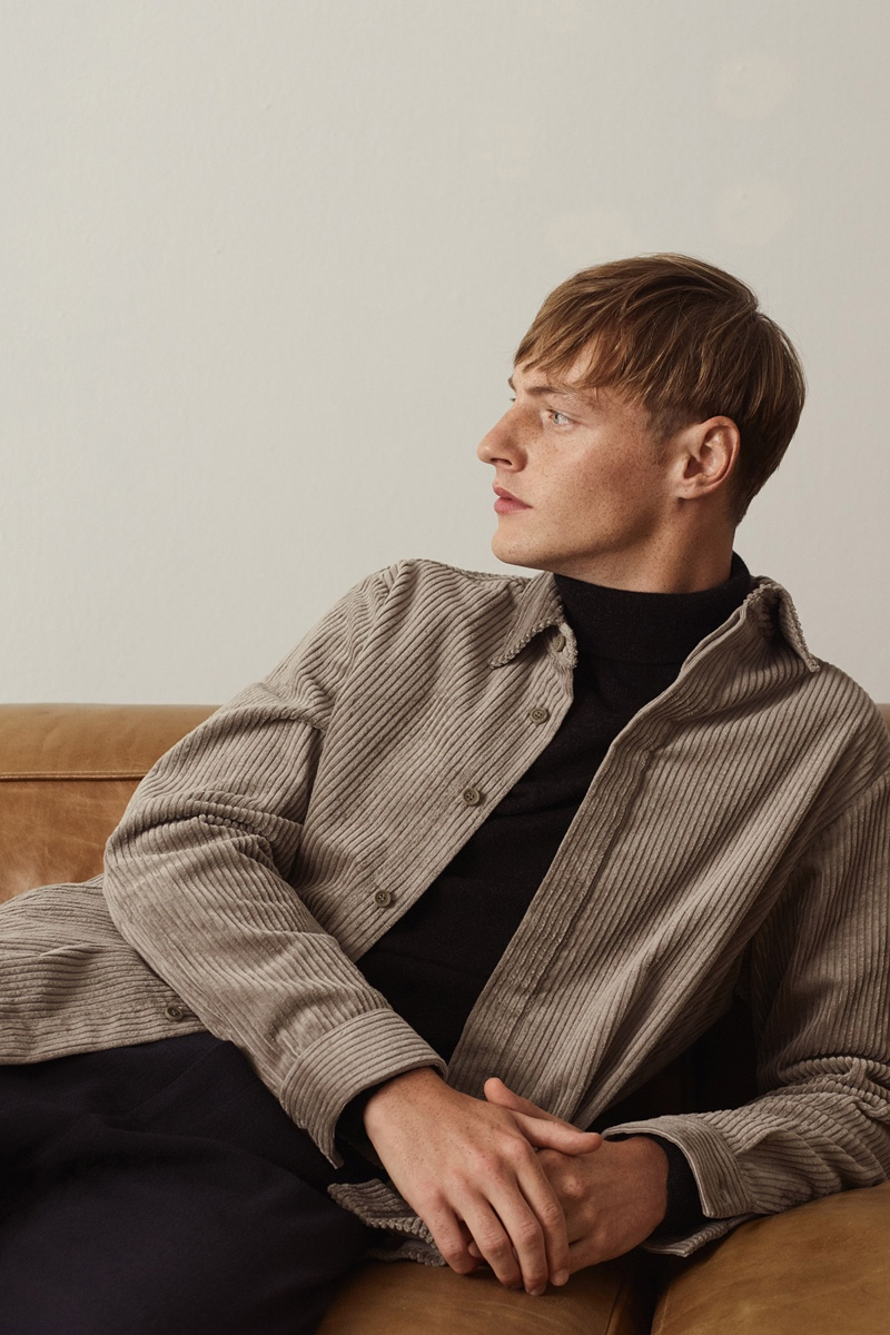 Model Roberto Sipos wears a corduroy overshirt with a turtleneck sweater from COS.