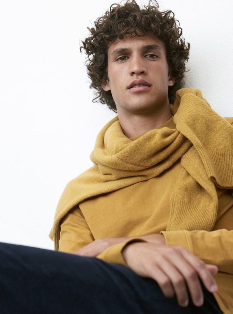 A chic vision, Francisco Henriques dons a gold long-sleeve mockneck tee $79.50 from Club Monaco.