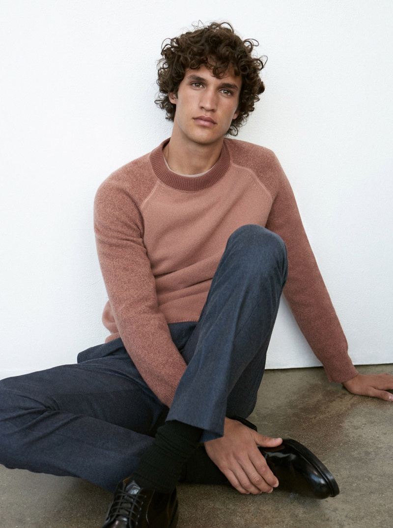 Front and center, Francisco Henriques wears a mauve garment-dyed sweater $149.50 from Club Monaco.