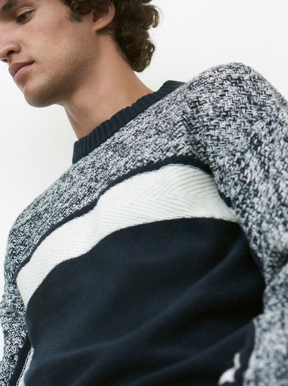 Making a graphic statement, Francisco Henriques wears a Club Monaco fisherman crewneck sweater $159.50.
