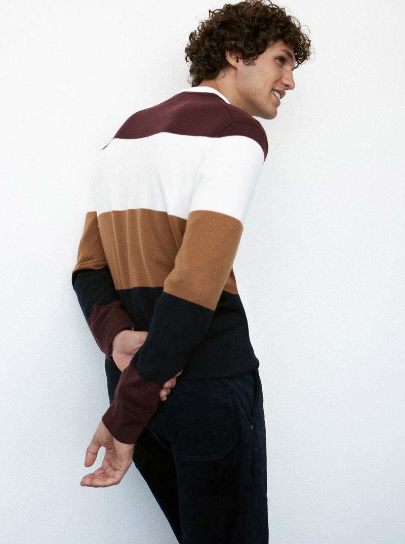 All smiles, Francisco Henriques dons a merino block stripe sweater $98.50 from Club Monaco.