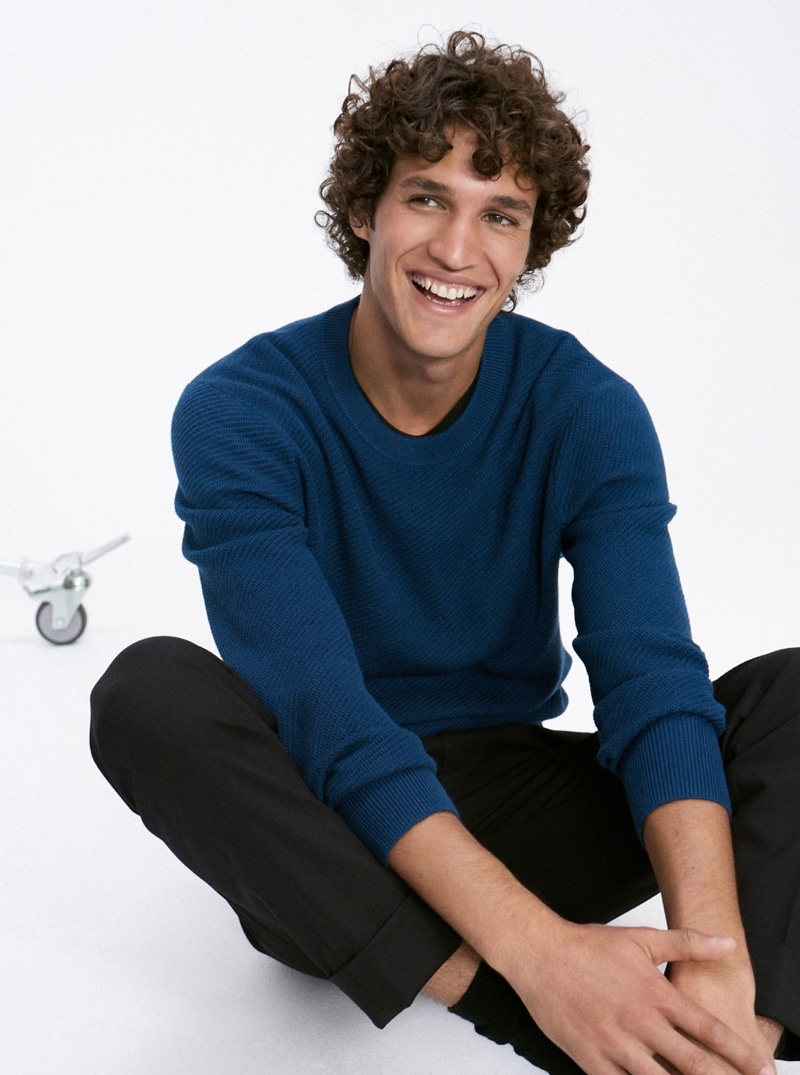 Connecting with Club Monaco, Francisco Henriques models a blue texture twill sweater $139.50.