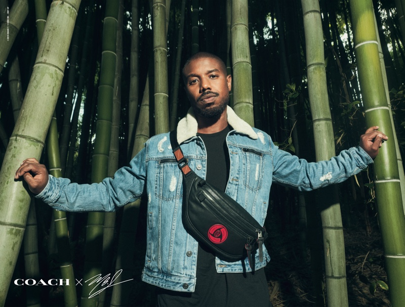 Actor Michael B. Jordan wears a leather belt bag and denim jacket from his Coach capsule collection.