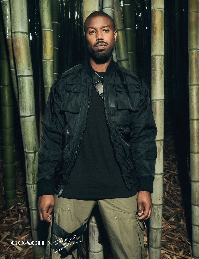 Front and center, Michael B. Jordan rocks a jacket and pants from his Coach capsule collection.