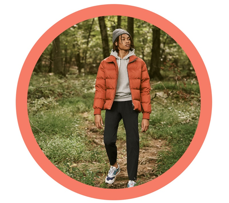 Front and center, Seth Hill sports a Moose Knuckles puffer jacket with a Barbour knit beanie. Reuniting with East Dane, he also wears a hoodie and pants by Reigning Champ with Karhu Synchron classic sneakers.