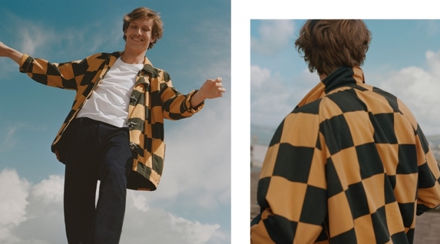 Sporting a checker print jacket, Felix Gesnouin stars in Esprit's fall 2019 campaign.