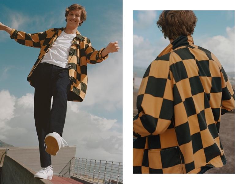 Sporting a checker print jacket, Felix Gesnouin stars in Esprit's fall 2019 campaign.