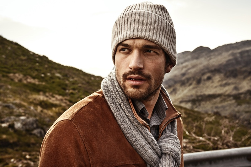 Model Paul Kelly wears a matching knit beanie and scarf from Eton's fall-winter 2019 collection.